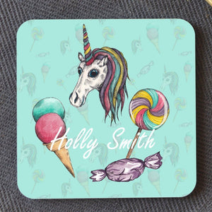 A mint green square coaster with a personalised unicorn design