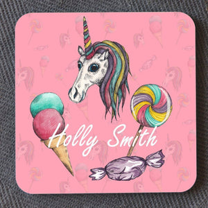 A personalised square coaster with a unicorn illustration on a pink background. The personalised element is an individuals name