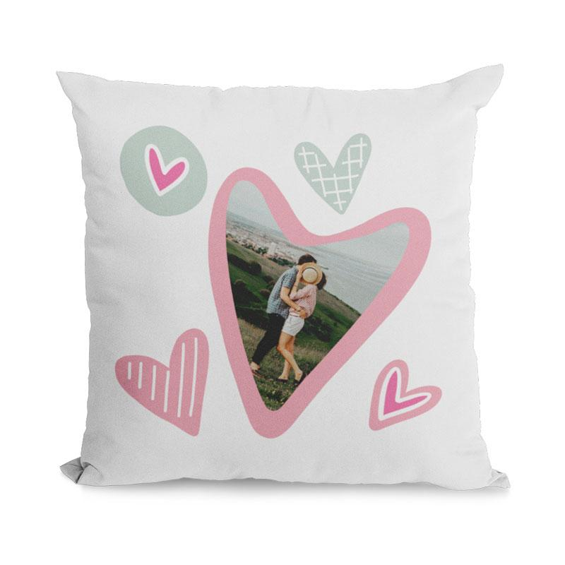 A personalised heart pattern cushion with a personal photograph printed in the centre of the largest heart