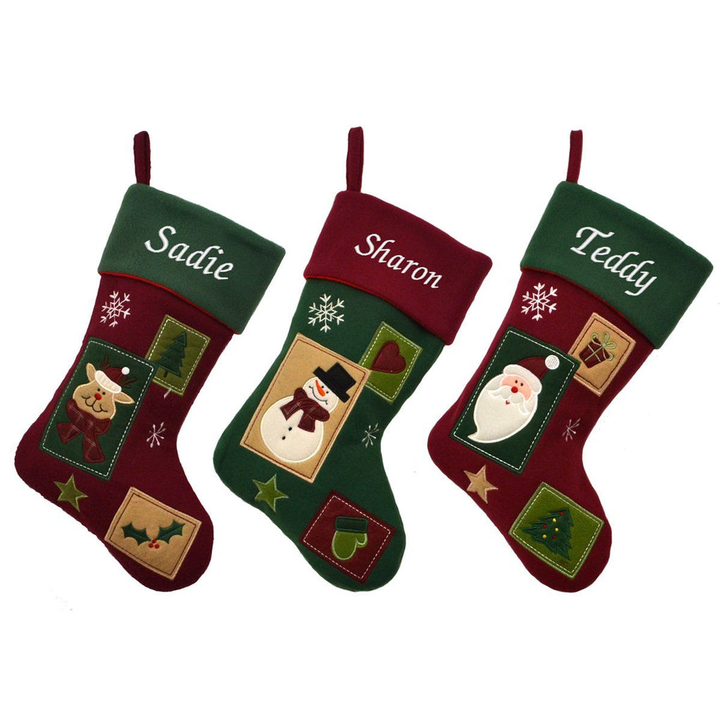 3 vintage style Christmas stockings with patchwork designs. Each stocking is personalised with a name which is embroidered in white lettering.