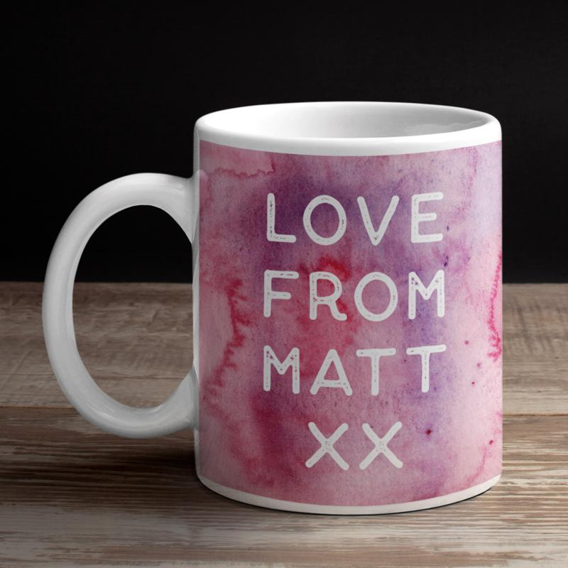 A personalised message printed on a pink and purple mug