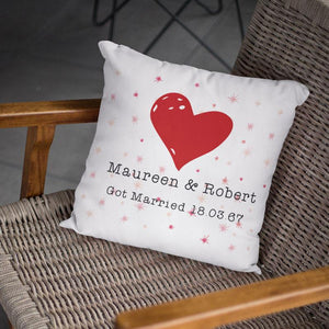 "A personalised white cushion with a heart and star design and the words ""Maureen & Robert Got Married 18.03.67"""