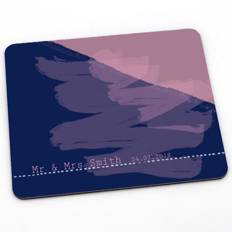 A personalised blue and pink placemat which is part of a wedding gift set