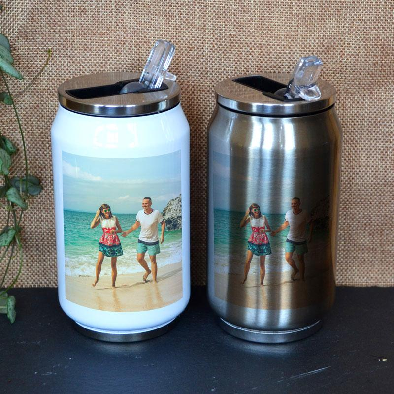 Two personalised photo water bottles in the shape of pop cans. One is silver and one is white. Both have a photo printed on them.