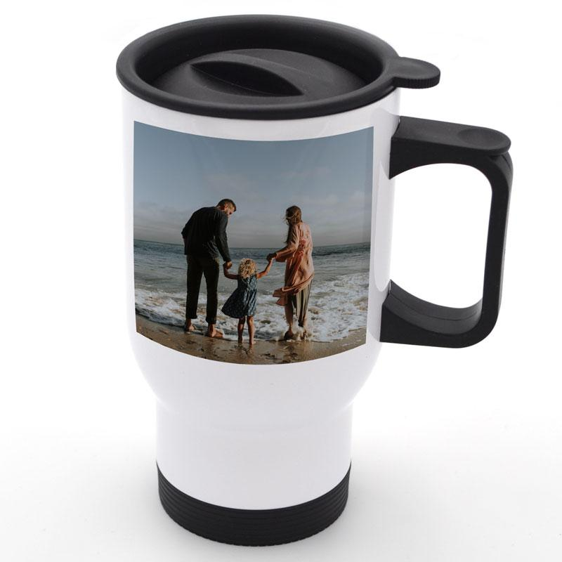 A personalised white travel mug with a family photo printed on it
