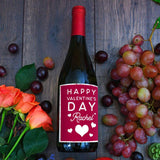 A bottle of red wine with a personalised Valentine's Day label
