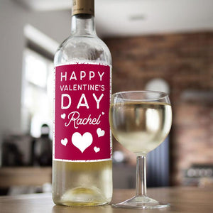 A bottle of white wine with a personalised Valentine's Day label