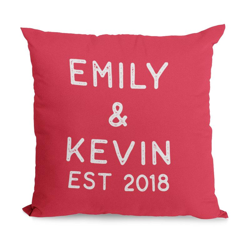 A red personalised cushion with custom white writing