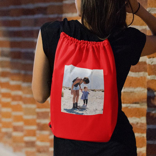 A personalised red drawstring gym bag with a photo printed onto it