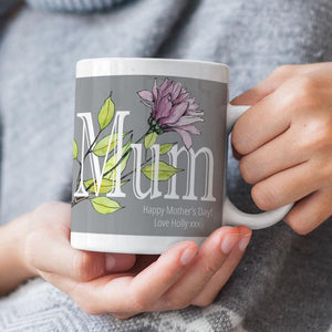 A personalised grey, pink and green Mother's Day mug.