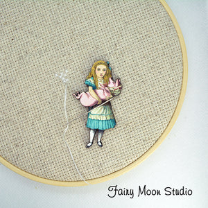 "Alice In Wonderland ""Alice with Pig"" Needle Minder"