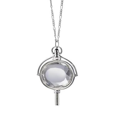 "MONICA RICH KOSANN STERLING SILVER LARGE OVAL SPINNING POCKETWATCH KEY W/CENTER ROCK CRYSTAL & WHITE SAPPHIRE ACCENT ON 36"" FIGARO CHAIN"