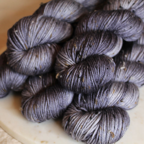 stack of grey yarn on a marble plate