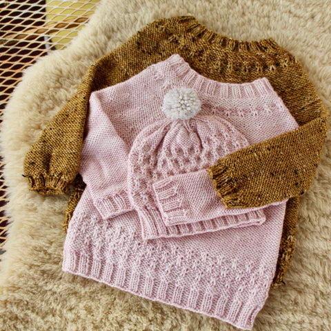 two sweaters nestled together from the Little Knits book by Marie Greene