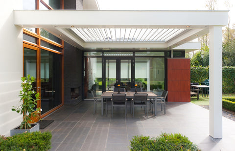 outdoor dining area with white pillar and tile floors