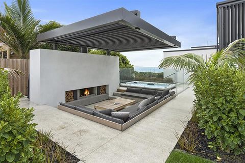 outdoor roof living space with white tiling and fireplace