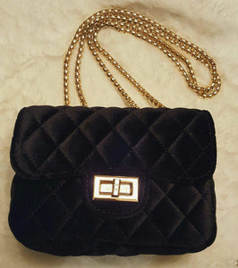 A Black Velvet Purse With Gold Chain