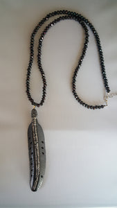 Long Beaded Necklace With Black Feather Pendant