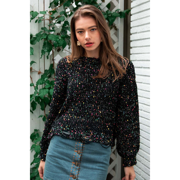Dotted multi knit sweater with distressed hem