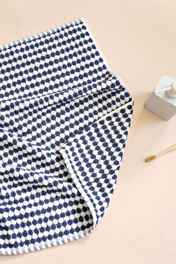 Shop Pom Pom Bath Mat | Navy at Rose St Trading Co
