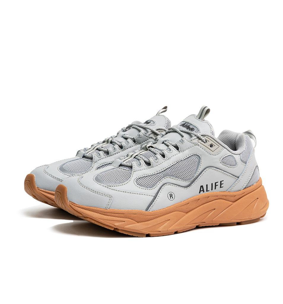 Alife FILA Trigate sneaker 1RM01564 in Grey/Gum 45 degree