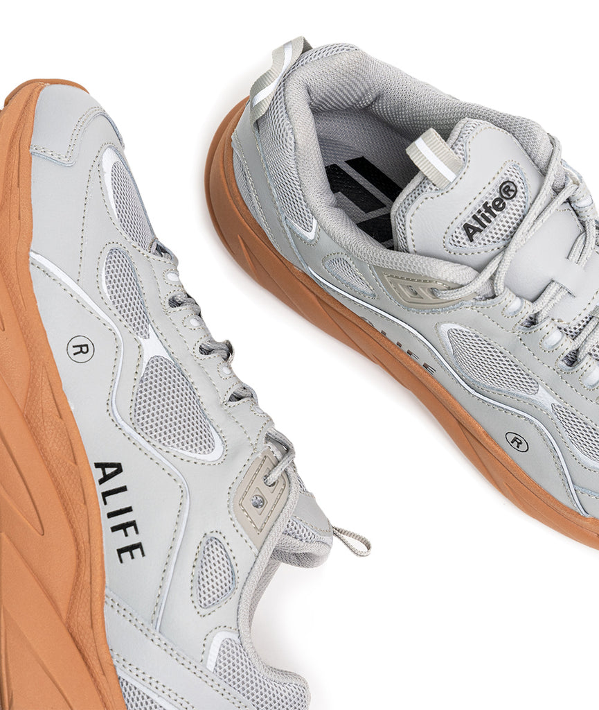 Alife FILA Trigate sneaker 1RM01564 in Grey/Gum top and side view