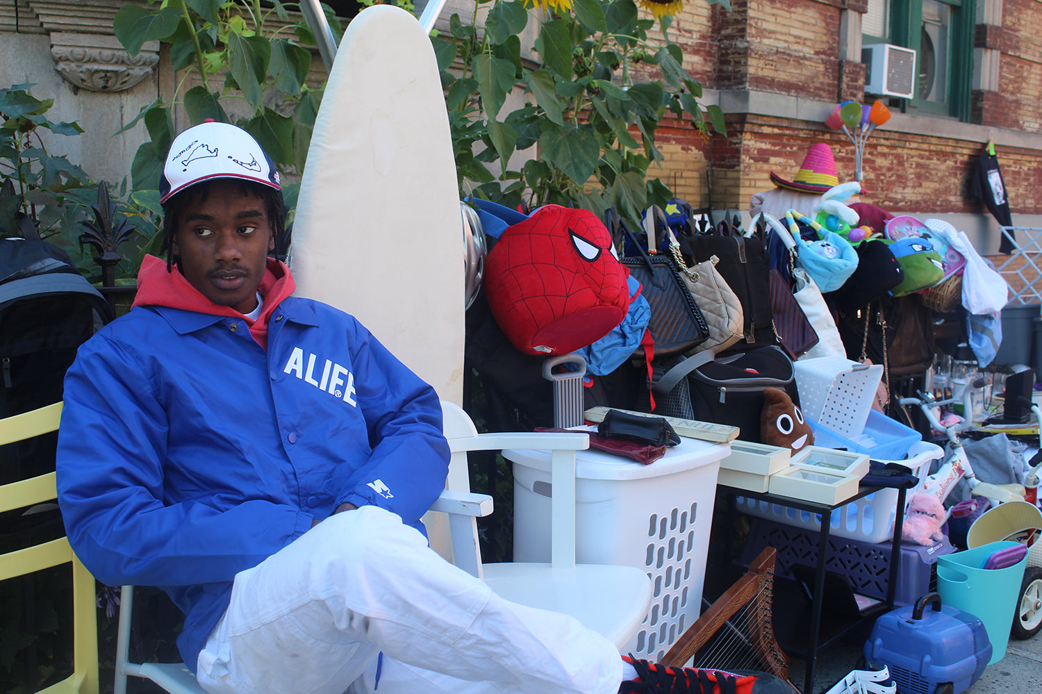ALIFE® Starter Coaches Jacket in Blue on model sitting down