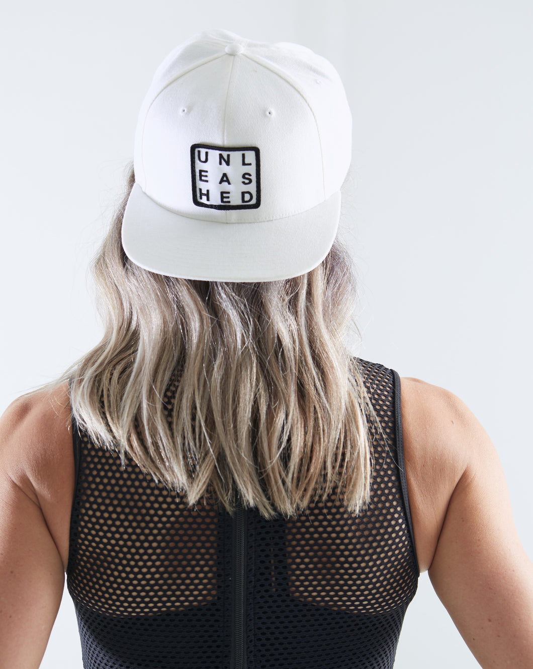 White Trucker Hat with White Unleashed Patch