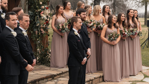 products/bridal-party-with-11-bridesmaids-and-10-groomsmen-stand-outside-at-venue-holding-flowers-waiting-for-bride-to-walk-down-aisle.jpg