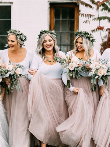 products/bride-in-wedding-dress-in-front-of-ivy-covered-house-venue-bridesmaids-in-pink-tulle-skirts-with-greenery-growns-smiling-with-maid-of-honor-and-mom.jpg