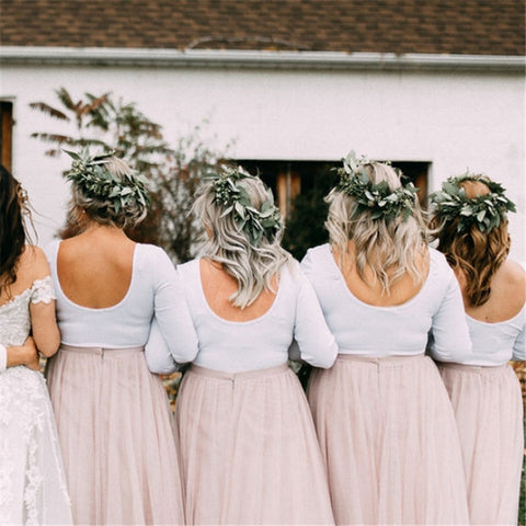 products/bride-with-7-bridesmaids-and-mother-in-pink-tulle-skirts-facing-back-greenery-flower-crowns-long-sleeve-white-shirts.jpg
