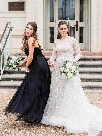 products/bridesmaid-in-black-tulle-black-tie-dress-bride-in-wedding-dress-lace-white-and-green-bouquet-greenery-dancing-and-posing-before-wedding-ceremony-best-friends_d8f5fd7b-ab96-478f-8854-086c978dd322.jpg