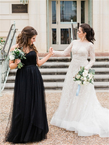 products/bridesmaid-in-black-tulle-black-tie-dress-bride-in-wedding-dress-lace-white-and-green-bouquet-greenery-dancing-and-posing-before-wedding-ceremony-best-friends.jpg