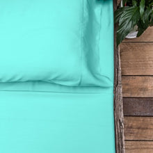 Aqua coloured organic bamboo bed sheet on bed
