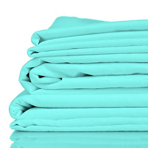 Stack of aqua coloured organic bamboo bed sheets folded up