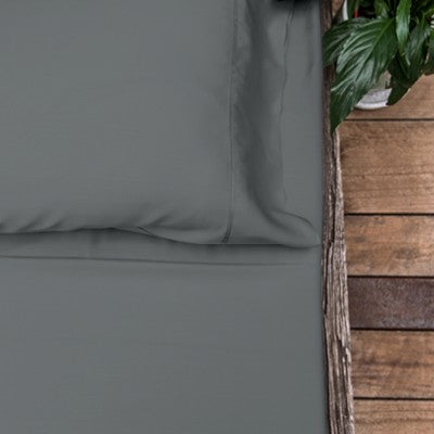 Charcoal coloured organic bamboo bed sheet on bed