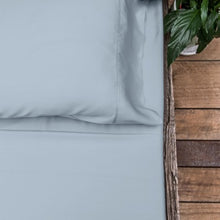Light blue coloured organic bamboo bed sheet on bed