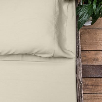Oatmeal coloured organic bamboo bed sheet on bed