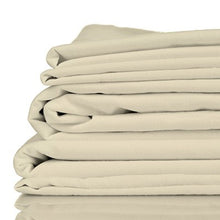 Stack of oatmeal coloured organic bamboo bed sheets folded up