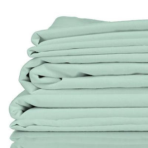 Stack of sage coloured organic bamboo bed sheets folded up