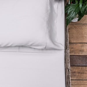 Light silver coloured organic bamboo bed sheet on bed