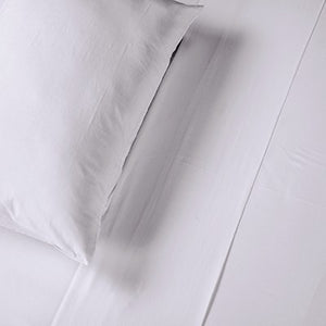 Close up of pillow case of silver coloured organic bamboo bed sheet on bed