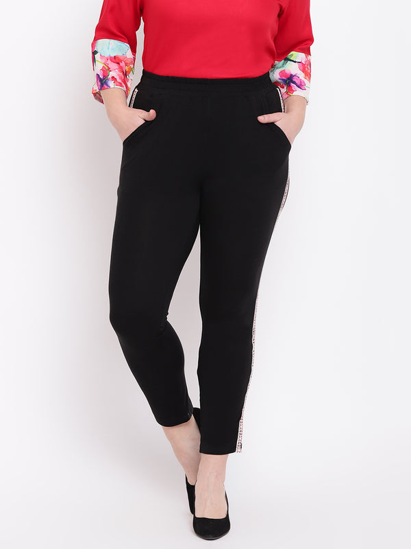 Women Black Solid Plus Size Track Pants