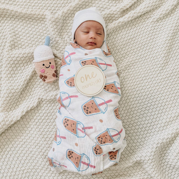 baby afsyar wrapped in boba swaddle