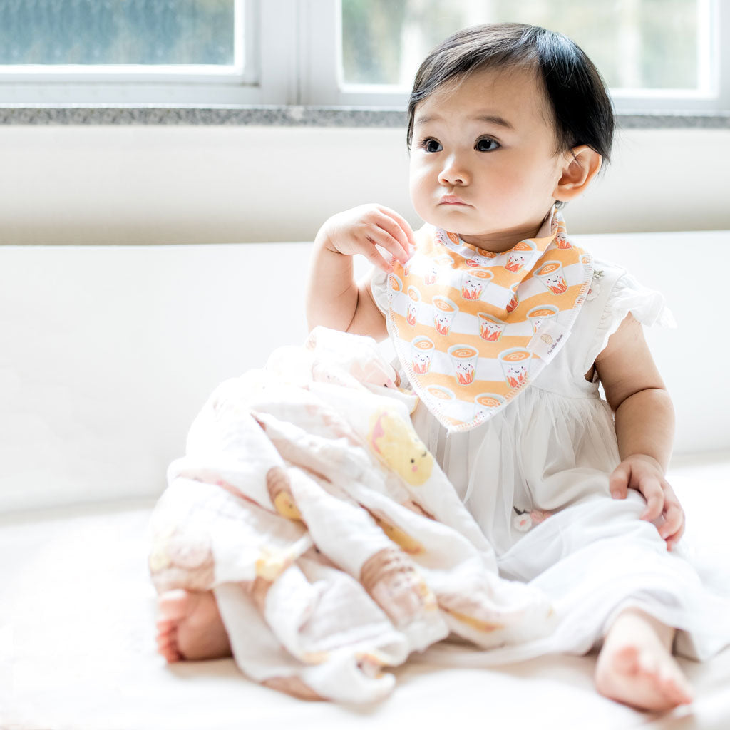 cute asian baby wearing milk tea organic cotton bandana bib and dim sum swaddle taste of hong kong collection the wee bean