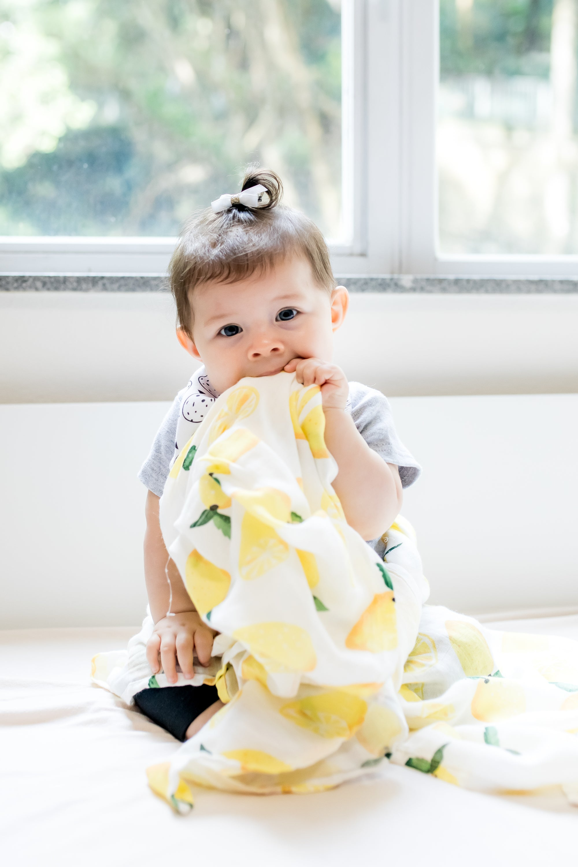 the wee bean cute baby teething biting organic cotton bamboo swaddle in lemon