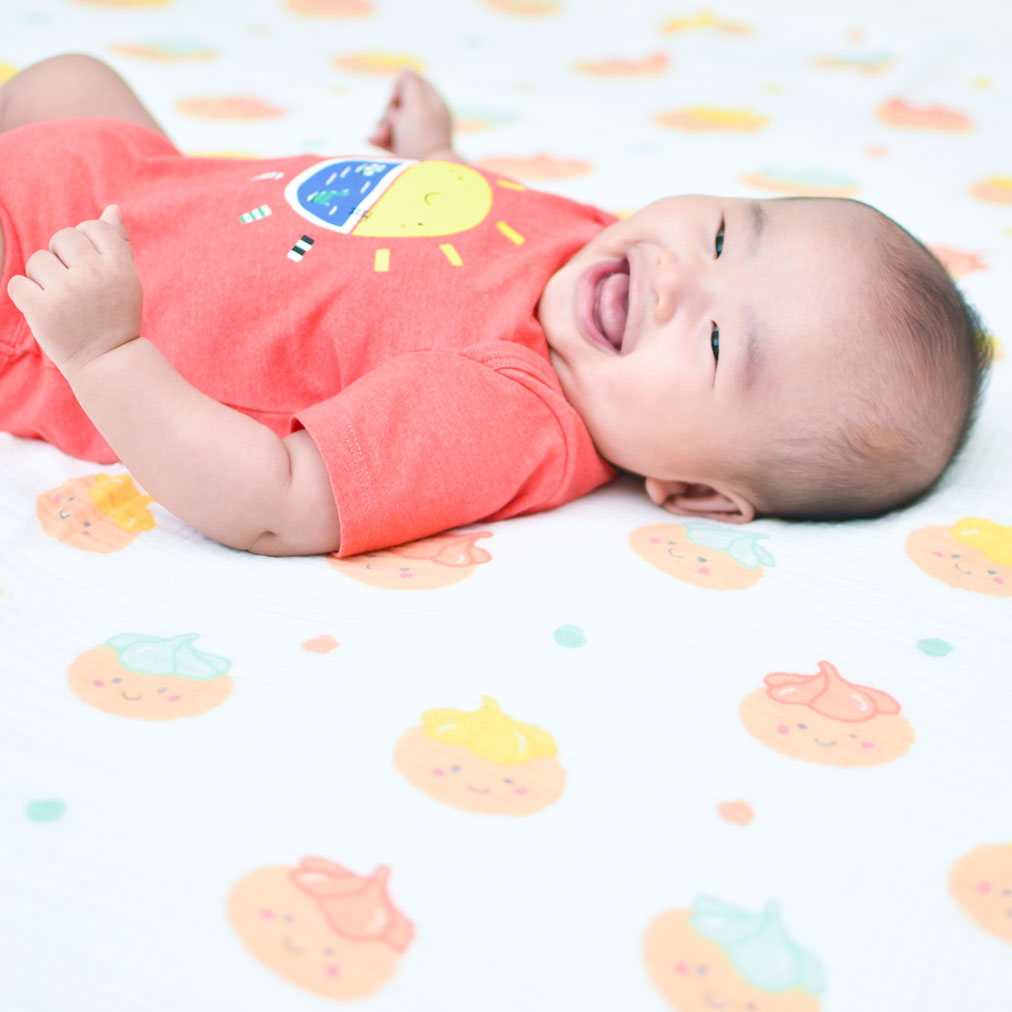 baby on organic swaddle with iced gem biscuit belly button print the wee bean taste of hong kong collection