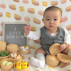 baby jayden posing with dim sum toys and the wee bean dim sum swaddle 1