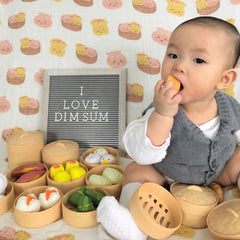 baby jayden posing with dim sum toys and the wee bean dim sum swaddle 2