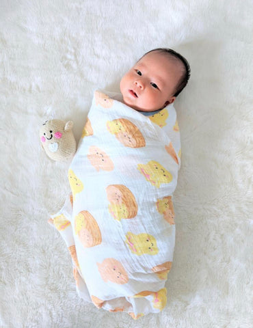 baby markus in dimsum organic swaddle the wee bean